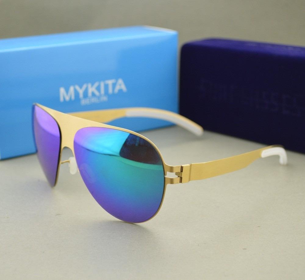 0ce3c5ba6927d mykita - óculos franz espelhado dourado com lente azul. Carregando zoom.