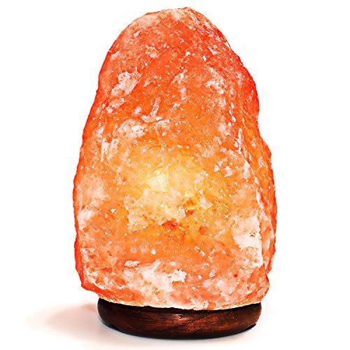 natural lámpara de sal del himalaya. mano tallada con base