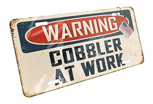 neonblond metal license plate warning cobbler