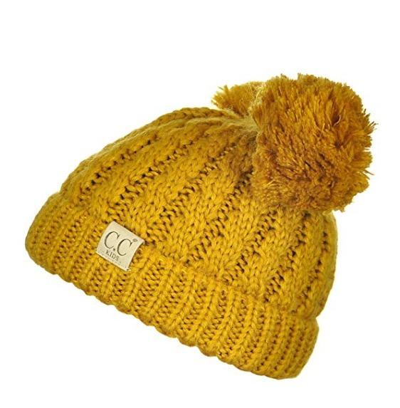 gorro de invierno para niñas y niños con pompones mustard k9 · gorro niños  con · niños con gorro 199fdc7b683