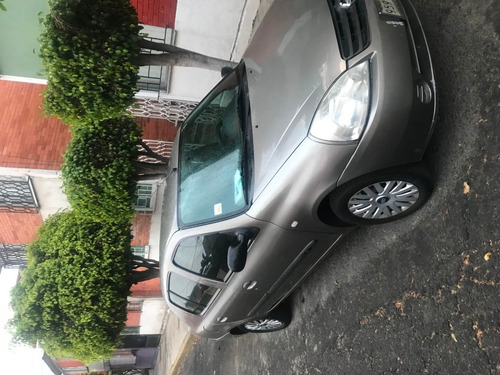 nissan, platina mod. 2004, 4 puertas, color gris capuccino