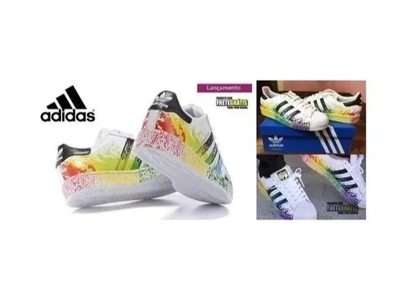 various colors d3afb 7759a Novo Tênis adidas Pride Pack Superstar Respingo De Tinta Top