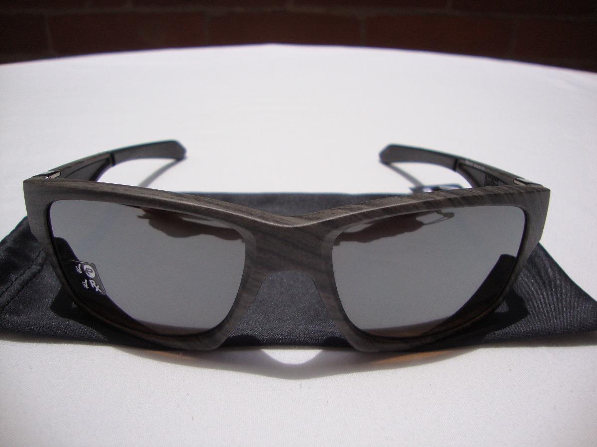 da53aee1f0 nuevas gafas oakley jupiter squared woodgrain polarizadas. Cargando zoom.