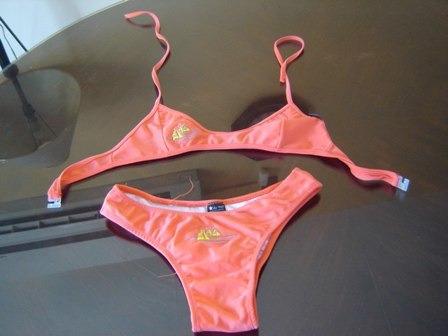 nuevo bikini de niña talle l, naranja fluor con diseño