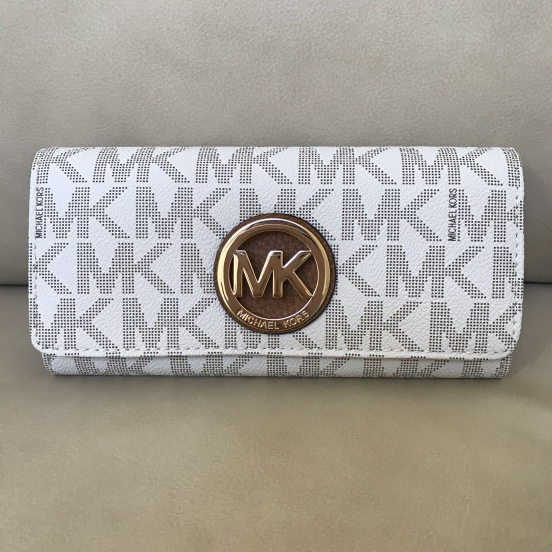 856eaed5e7dc40 nwt michael kors fulton flap continental leather pvc wallet. Cargando zoom.