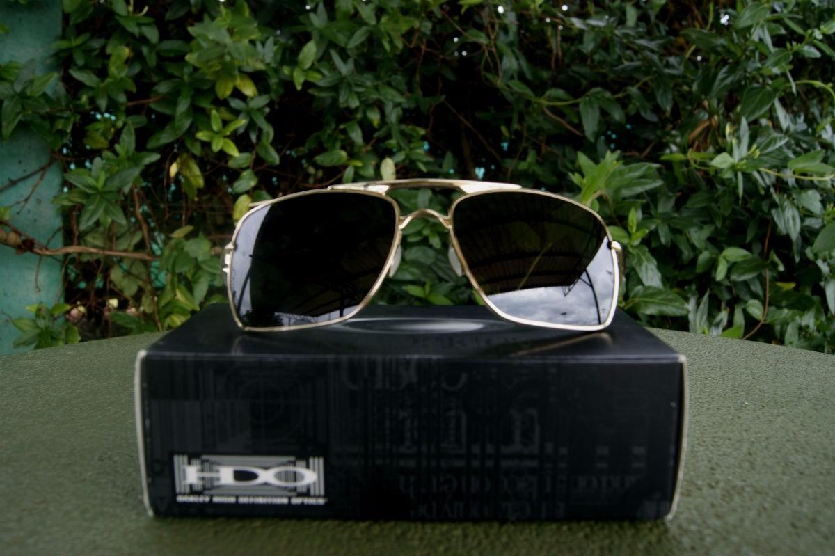 3342b8411892a oakley deviation dourado oo4061-02 novo original. Carregando zoom.