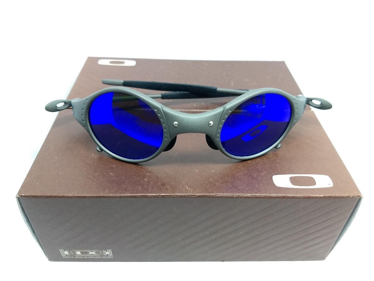 c942a3cbd1e1d Oculos Oakley Juliet 24k Mars Medusa Fosca Lente Azul - R  120