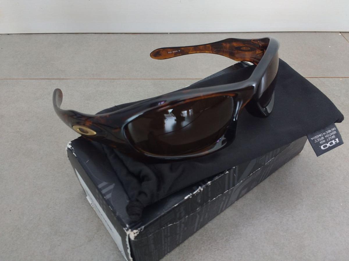 683e4ca57 Oakley Monster Dog 05-013 Marrom Lentes Descascando - R$ 299,00 em ...