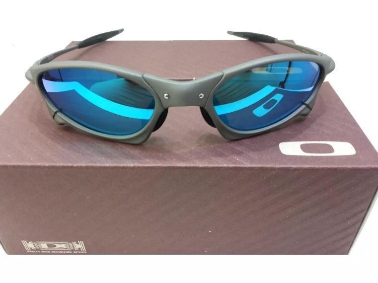 ee4c7541b446f Oculos Oakley Penny Blue 12x Top Cx + Saquinho Oakley Azul - R  120 ...