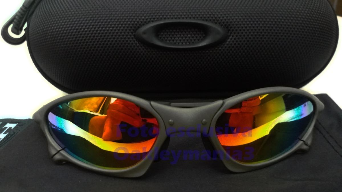 9058bd995dc27 oakley penny xmetal lente arco iris polarizada + case u.s.a. Carregando  zoom.