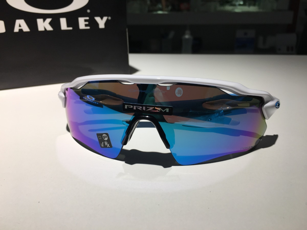 06b29d9bee7eb oakley performance radar ev path white lente prizm sapphire. Carregando  zoom.