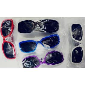 90697ad56f209 Óculos Com Furinhos Reticulado Furadinhos Original + Revista