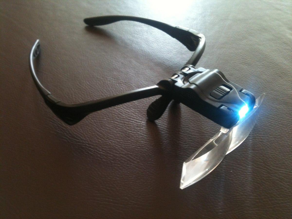 dcedbdf7ac781 óculos com kit de lentes e luz de led p conserto celular. Carregando zoom.