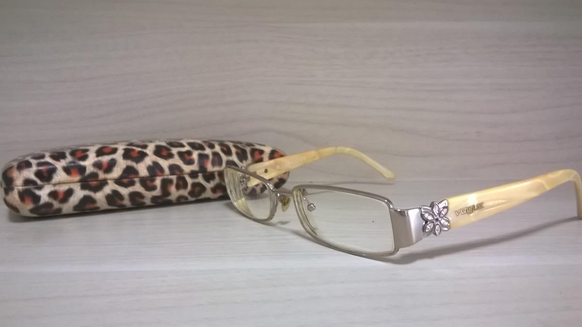 511eeeb7c óculos de grau vogue original em bom estado completo. Carregando zoom.