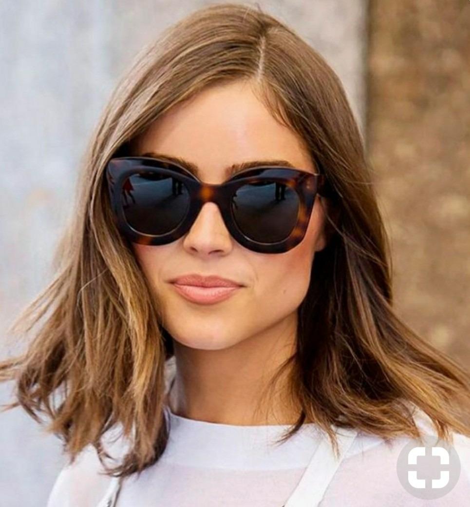 44306b93544a2 óculos de mulher grande quadrado marrom oncinha lente escura. Carregando  zoom.