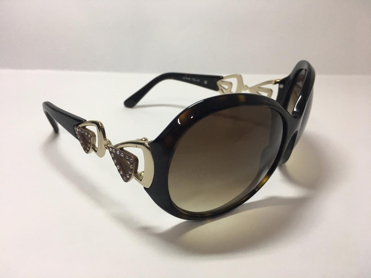 330cab194 óculos de sol feminino marrom detalhes laterais - via lorran. Carregando  zoom.