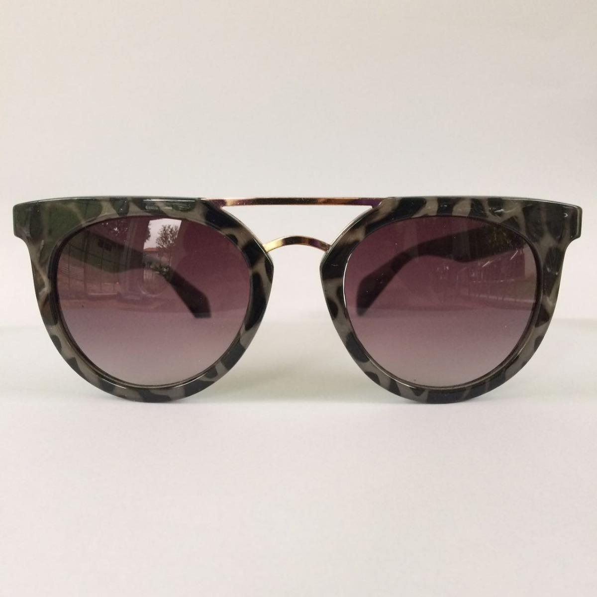 óculos de sol feminino redondo cinza oncinha proteção uv400. Carregando  zoom. 33ca8ac696