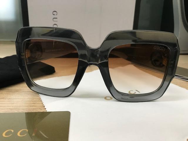... Óculos De Sol Gucci Quadrado Grafite Gg0053s - R 299,00 em Mercado . a1ca8dfb47