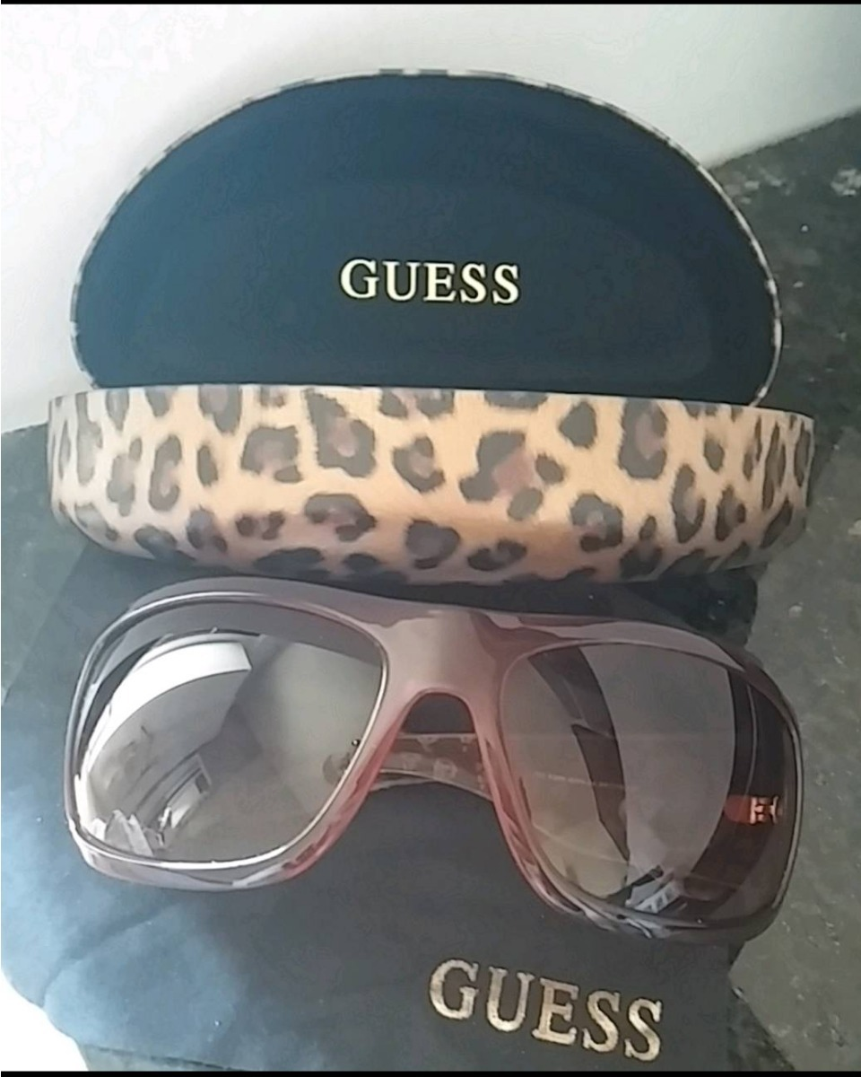61e6d9b93 óculos de sol guess c/caixa e lenço oncinha original. Carregando zoom.