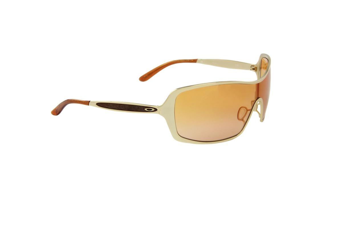 fed14294d2b9c óculos de sol oakley 100% proteção uv ópticas melani dourado. Carregando  zoom.