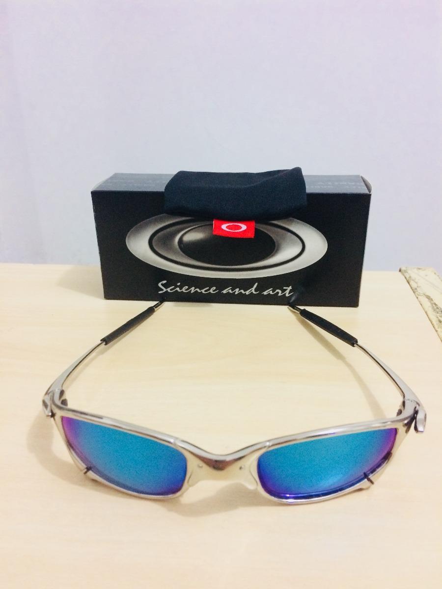 3456a205fc5f7 oculos de sol oakley juliet doblex cromada ice blue barato. Carregando zoom.