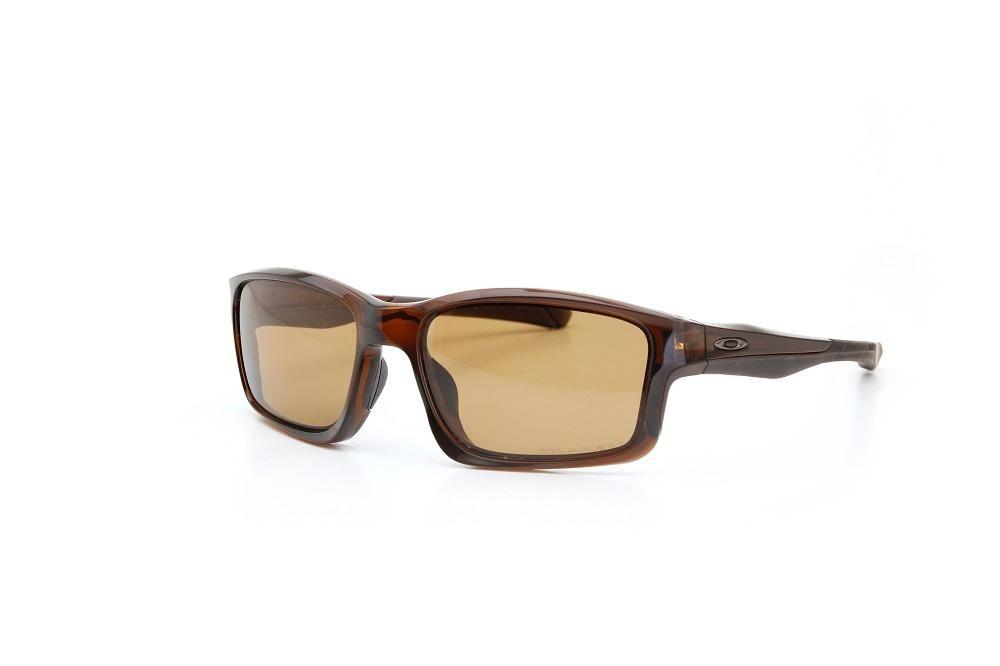 c1a3995283fc5 óculos de sol oakley lentes polarizadas proteção u.v marrom. Carregando  zoom.
