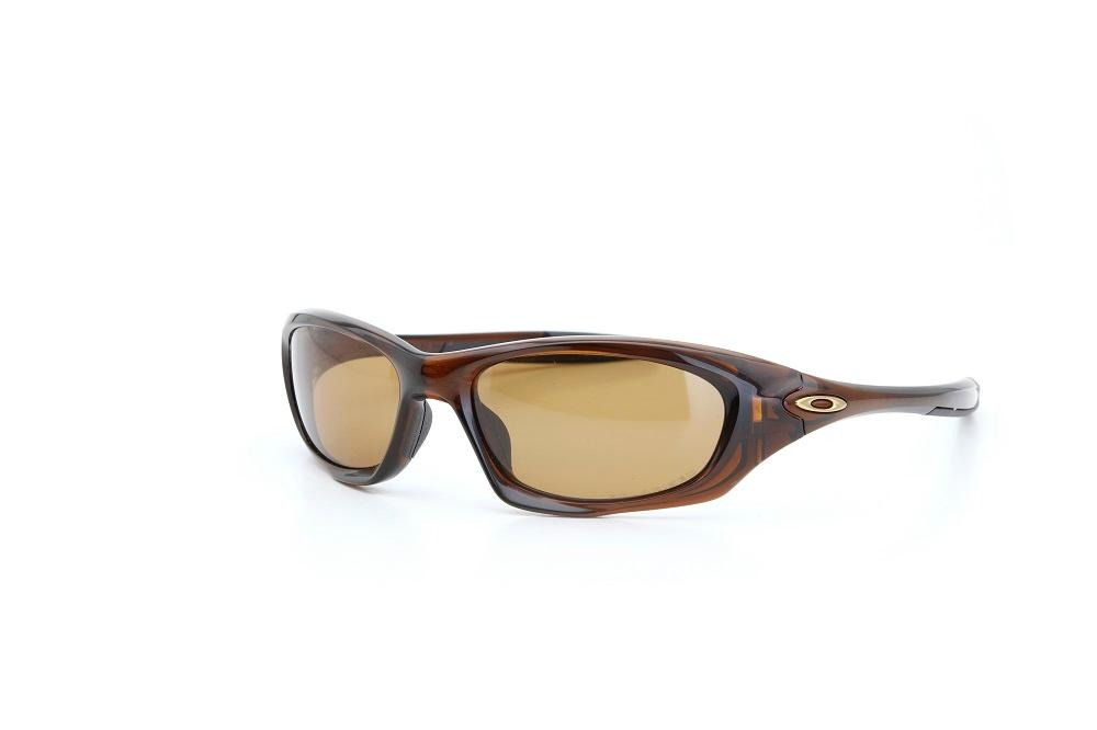 5c7386b73cf13 óculos de sol oakley proteção u.v haste emborrachada marrom. Carregando  zoom.