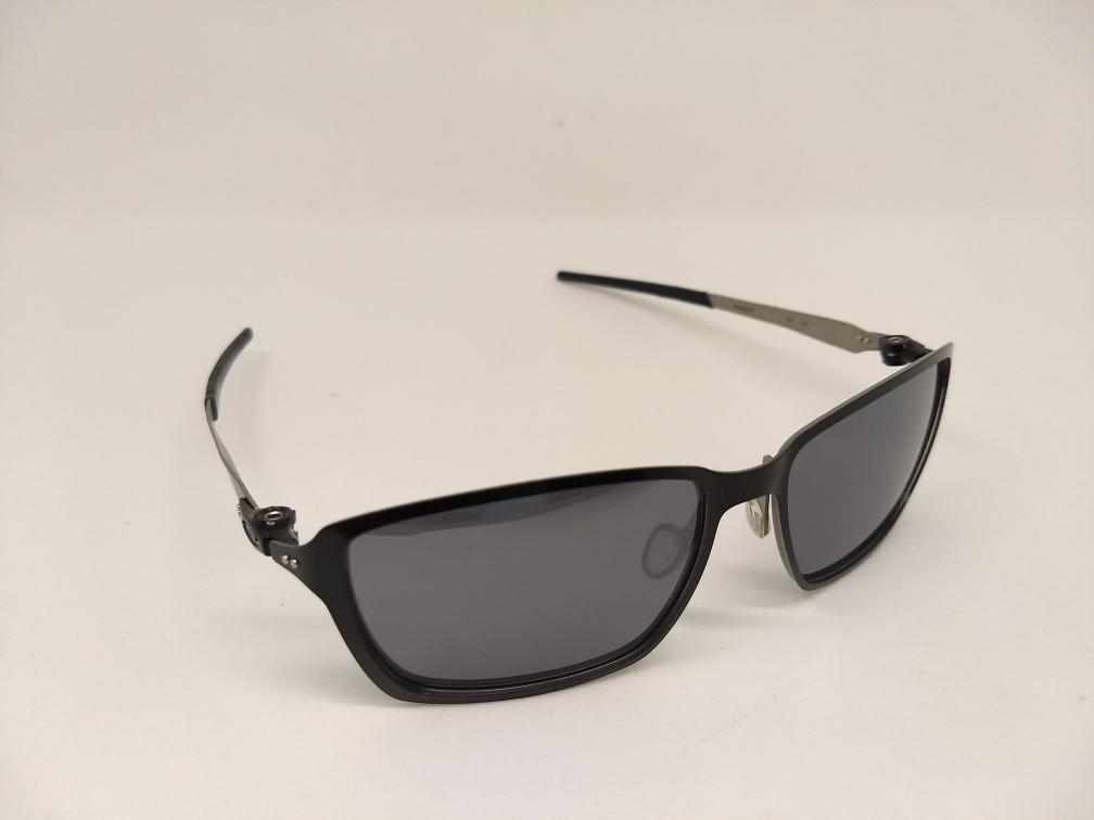 7130af8912ee5 oculos de sol oakley tincan iridium 4082 03 preto + brinde. Carregando zoom.