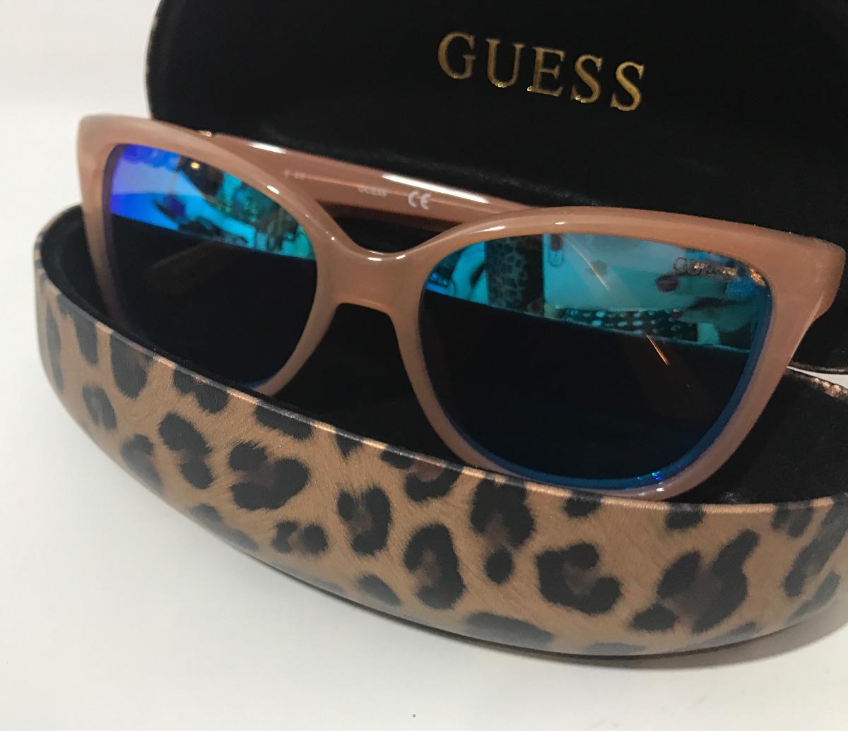 fda612c44bfe4 oculos de sol original guess nude lente espelhada azul + fg. Carregando  zoom.