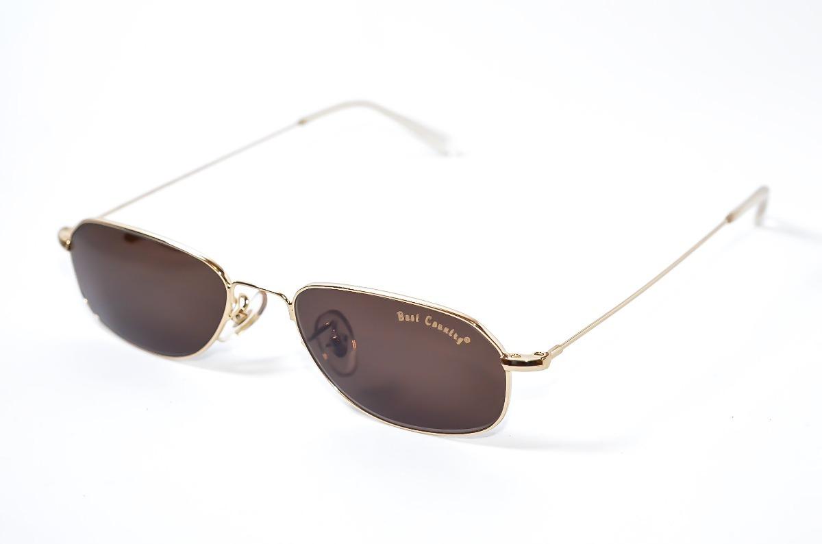 675f5fea9a2d3 oculos de sol pequeno classico dourad masculino best country. Carregando  zoom.
