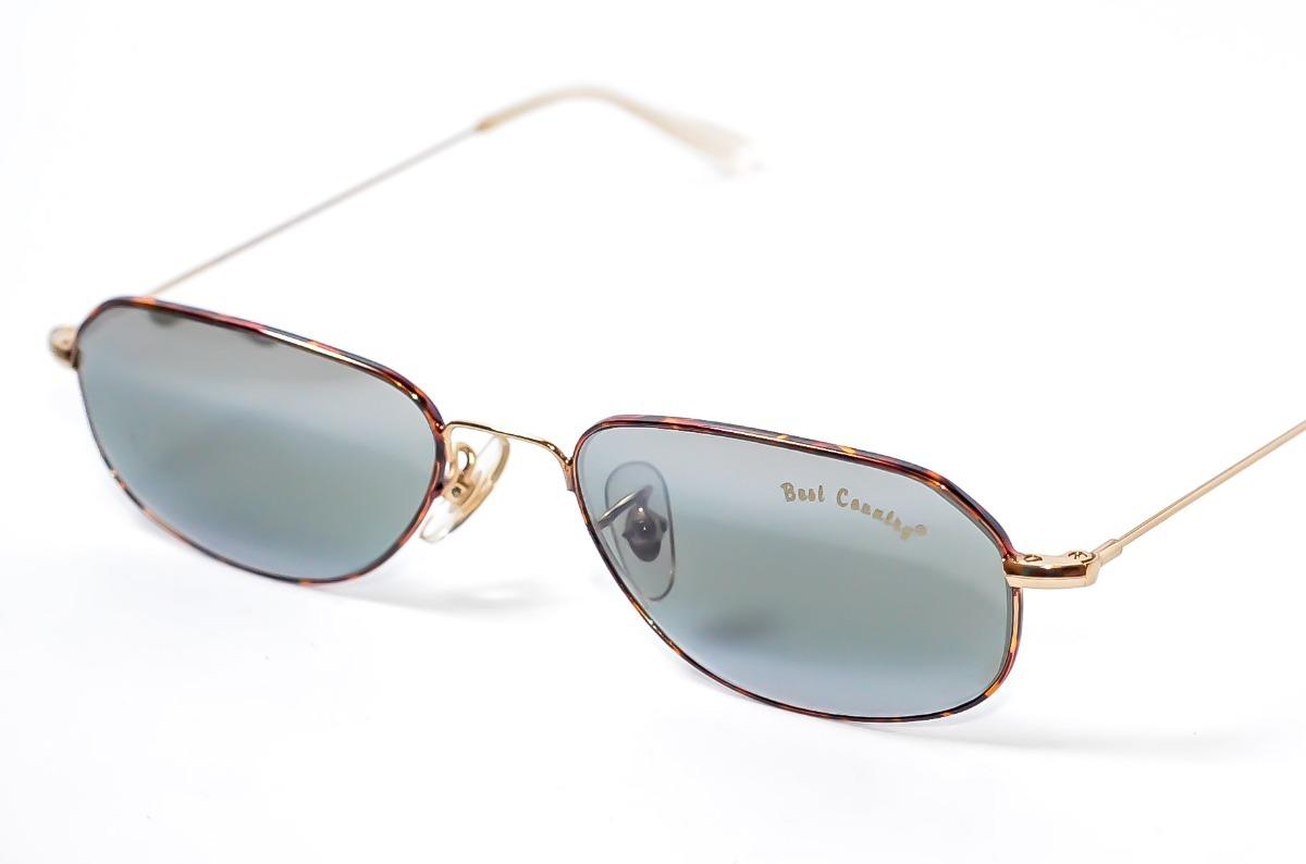 2fbefe153f00a oculos de sol pequeno classico masculino best country dourad. Carregando  zoom.