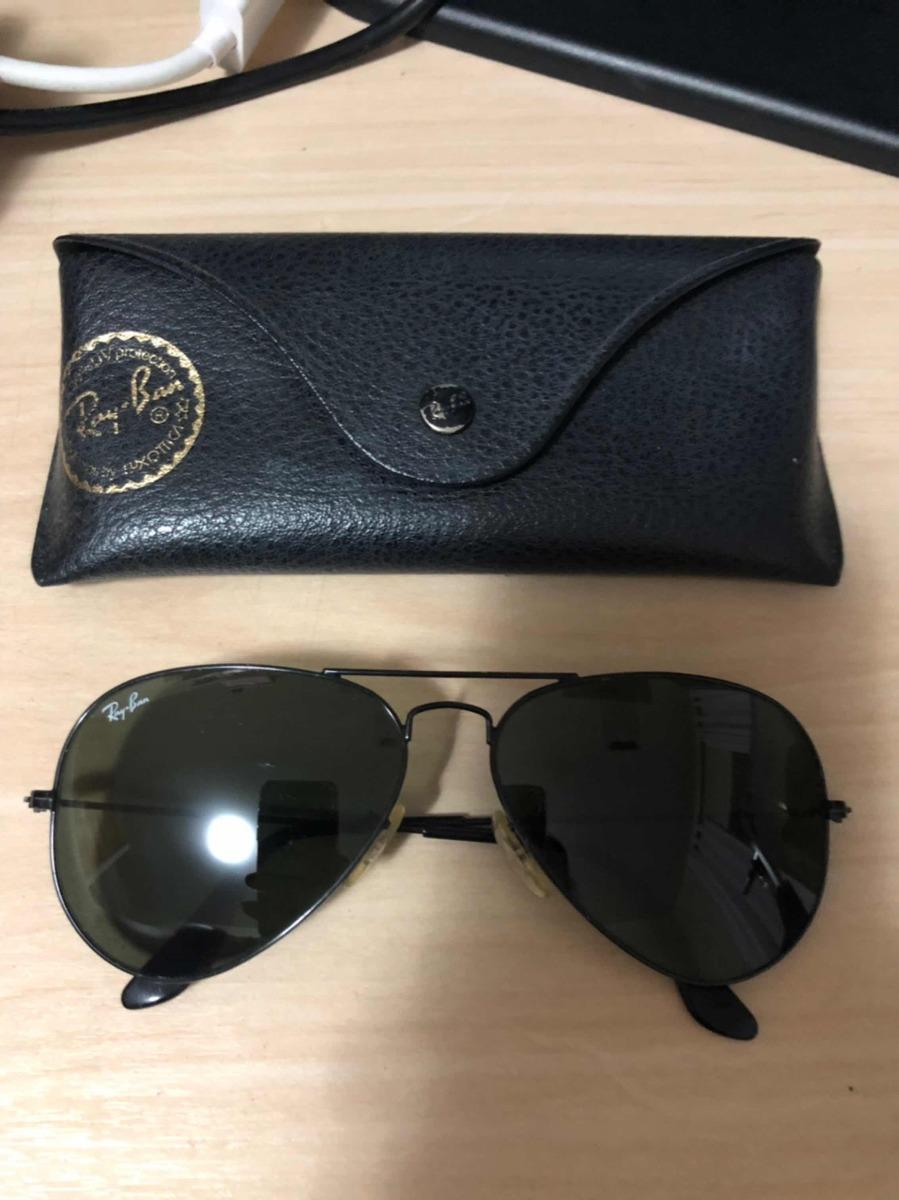 c519427e4 óculos de sol ray ban aviador original usado com capinha. Carregando zoom.