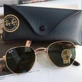 ea887c72d2113 Óculos De Sol Ray-ban Hexagonal Preto C dourado Feminino Top - R  78 ...