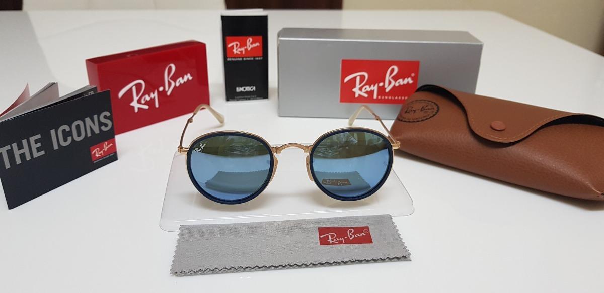 eb055b78e óculos de sol ray-ban round dobrável rb3517 azul espelhado. Carregando zoom.