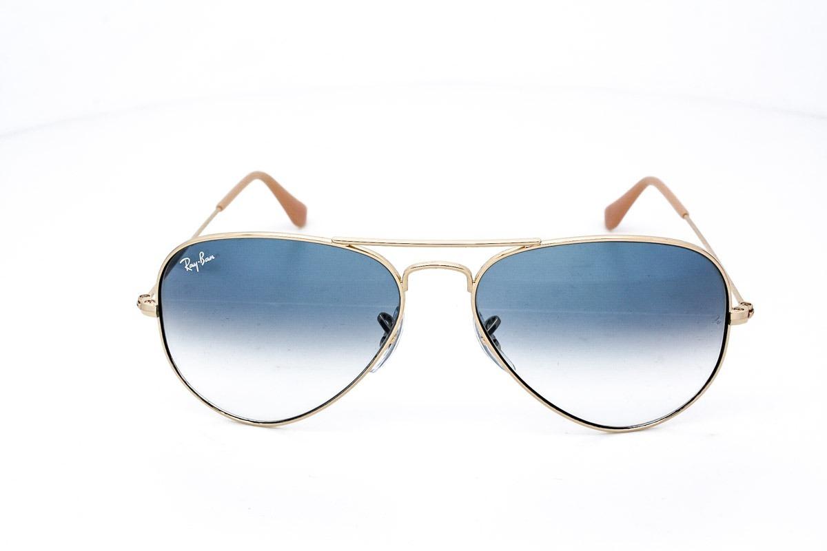 0bf5fbdb2d3a3 óculos de sol rayban aviador rb3025 dourado azul degrade. Carregando zoom.