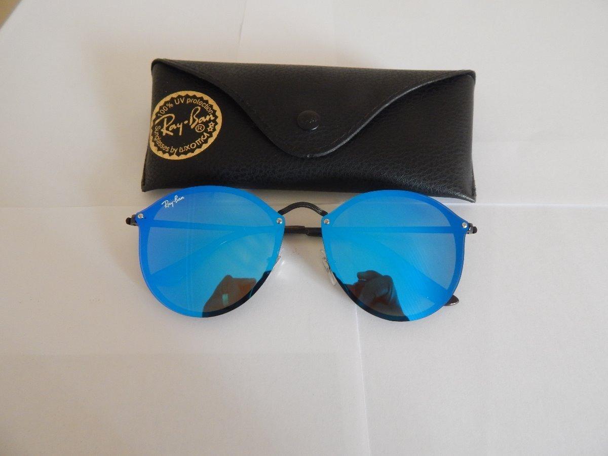 268ba3b01ee8b óculos de sol rayban blaze round rb3574 preto azul original. Carregando zoom .