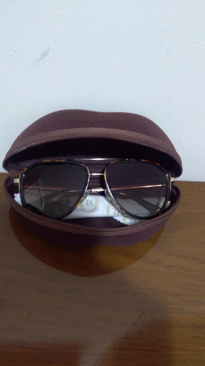 d63017846 óculos de sol via lorran 4041 c2 aviador dourado e marrom. Carregando zoom.