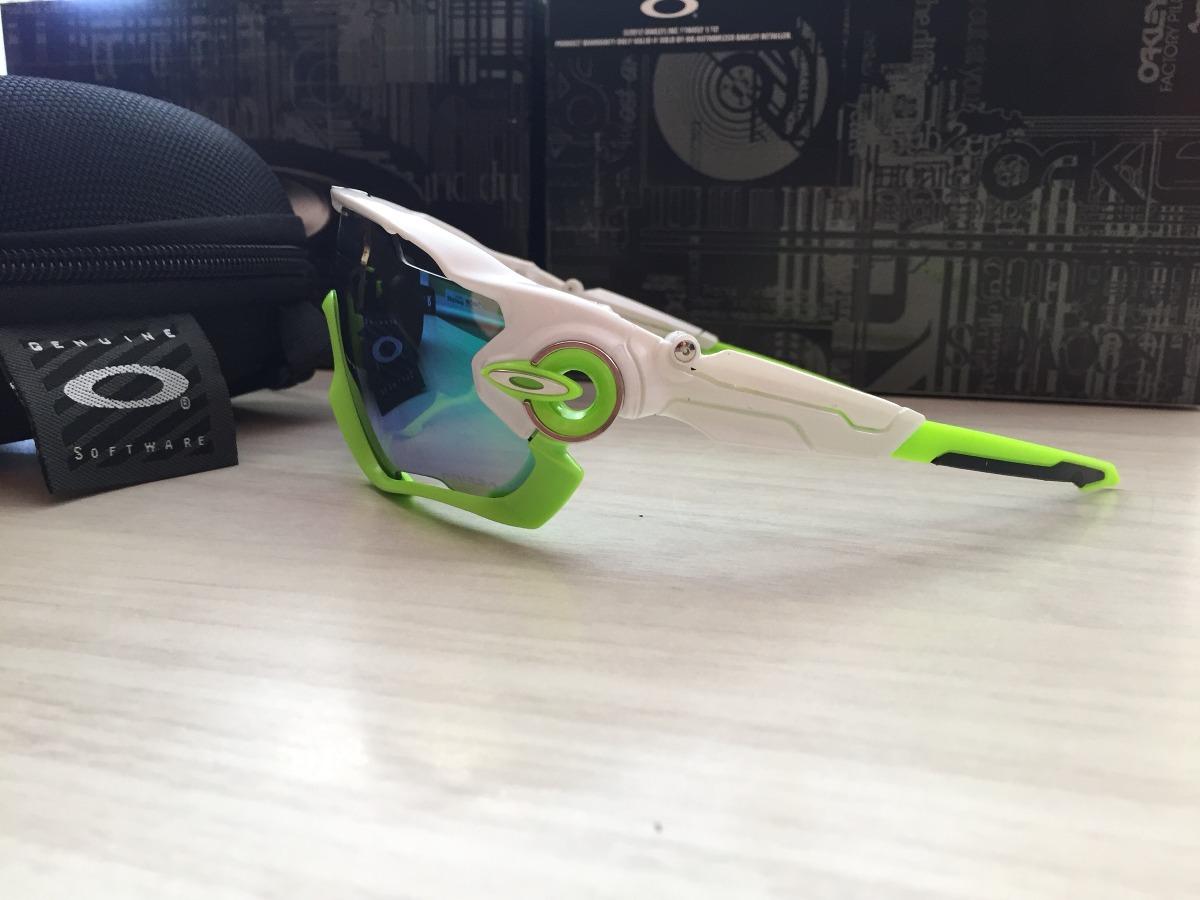 d6e018e17c7e5 óculos jawbreaker com 5 lentes no box branco com verde limao. Carregando  zoom.