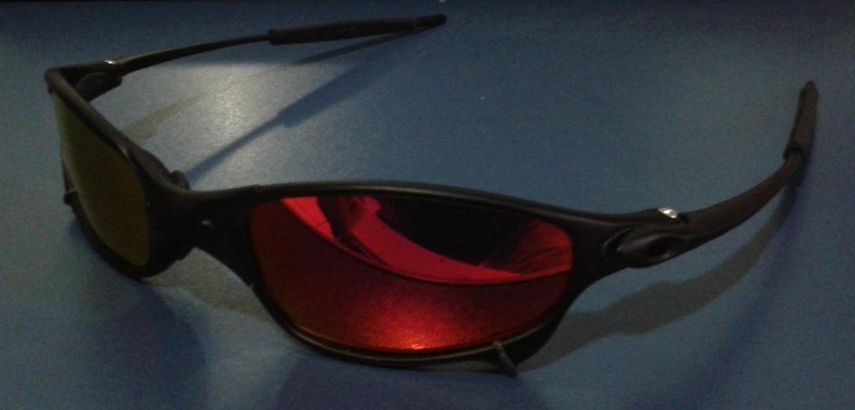 e53ed47a8428b oculos juliet xmetal preto fosco lente dark rubi polarizada. Carregando zoom .