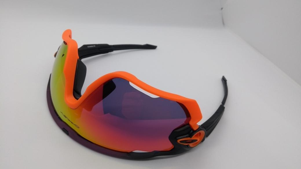 25cb89a161e0e óculos modelo oakley jawbreaker 5 lentes preto roxo laranja. Carregando  zoom.