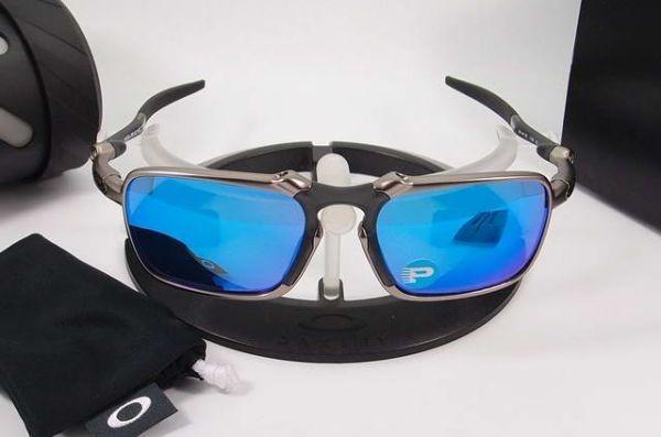 8fce3374d Óculos Oakley Badman Prata Azul Polarizado Cod04567 - R$ 159,99 em ...