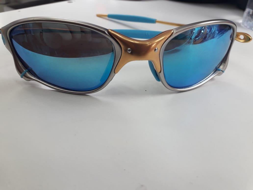 e9d93502219f2 Oculos Oakley Double X 24k Azul + Caixa + Bag + Certificado - R  120 ...