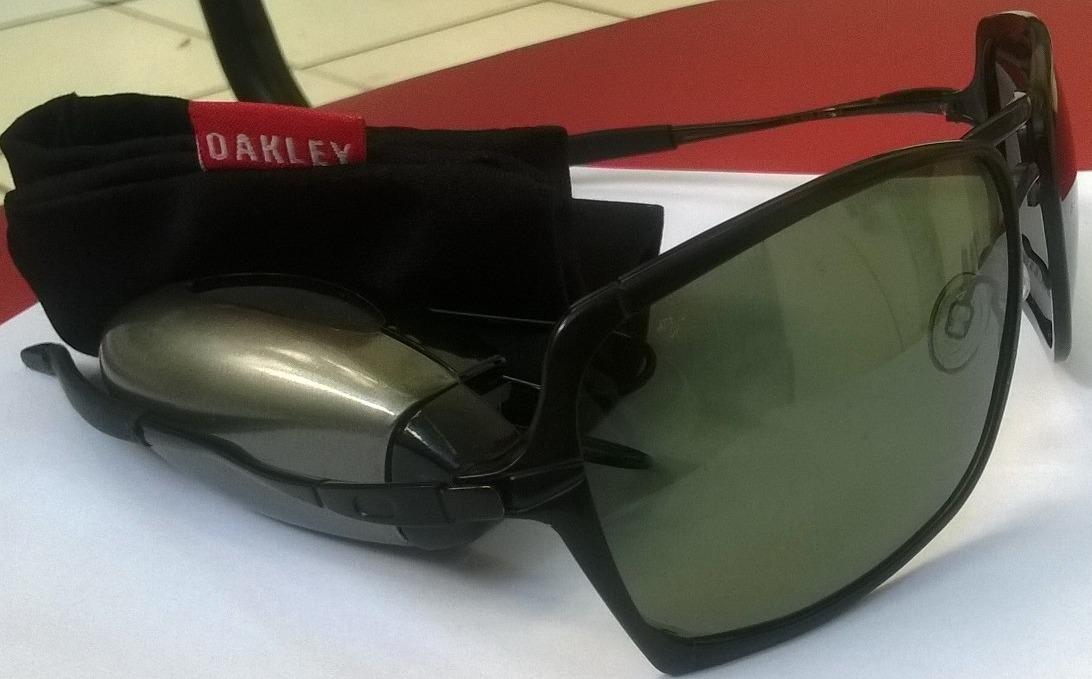905dc7645e751 oculos oakley inmate grafite lente polarizada + brinde. Carregando zoom.