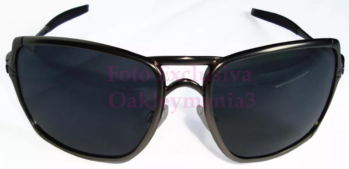9f37e7fe10102 oculos oakley inmate grafite lentes black polarizadas uv400. Carregando zoom .