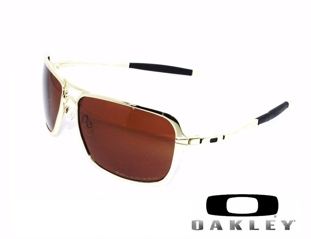 3f7b4548c9bcd Óculos Oakley Inmate Polished Silver Gold Polarizado Cod0234 - R  12 ...