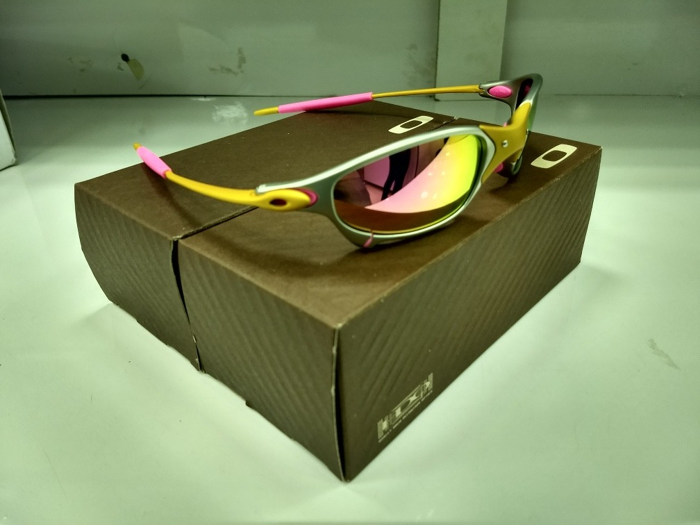 3a3821a74 oculos oakley juliet 24k rosa +lentes+borracha+chave+teste. Carregando zoom.