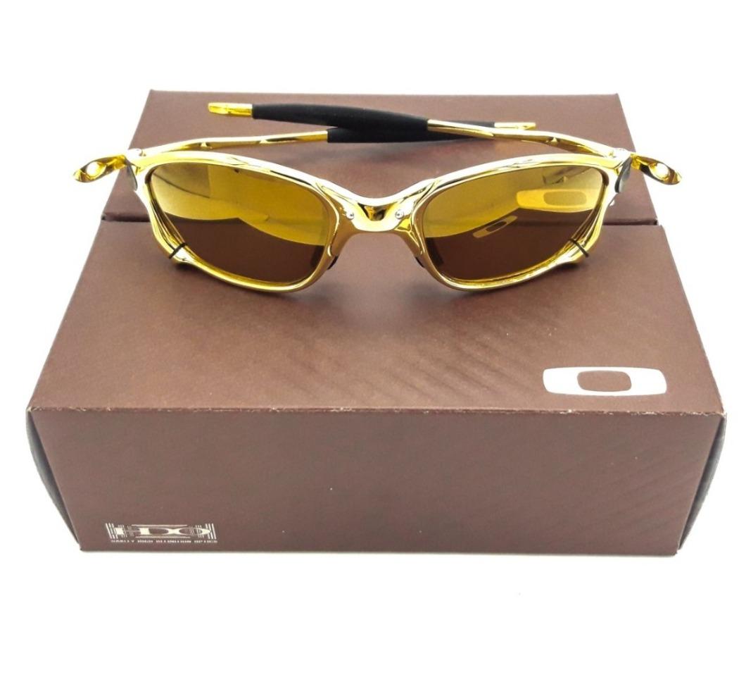 49ad234025ccb oculos oakley juliet gold polarizado metal borracha preta!! Carregando zoom.