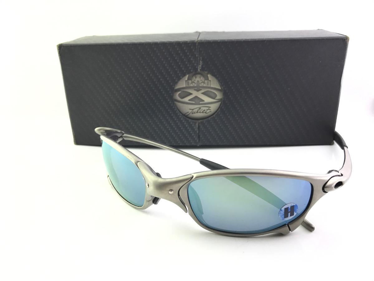 338e93bdf81eb óculos oakley juliet plasma emerald novo sem uso original. Carregando zoom.