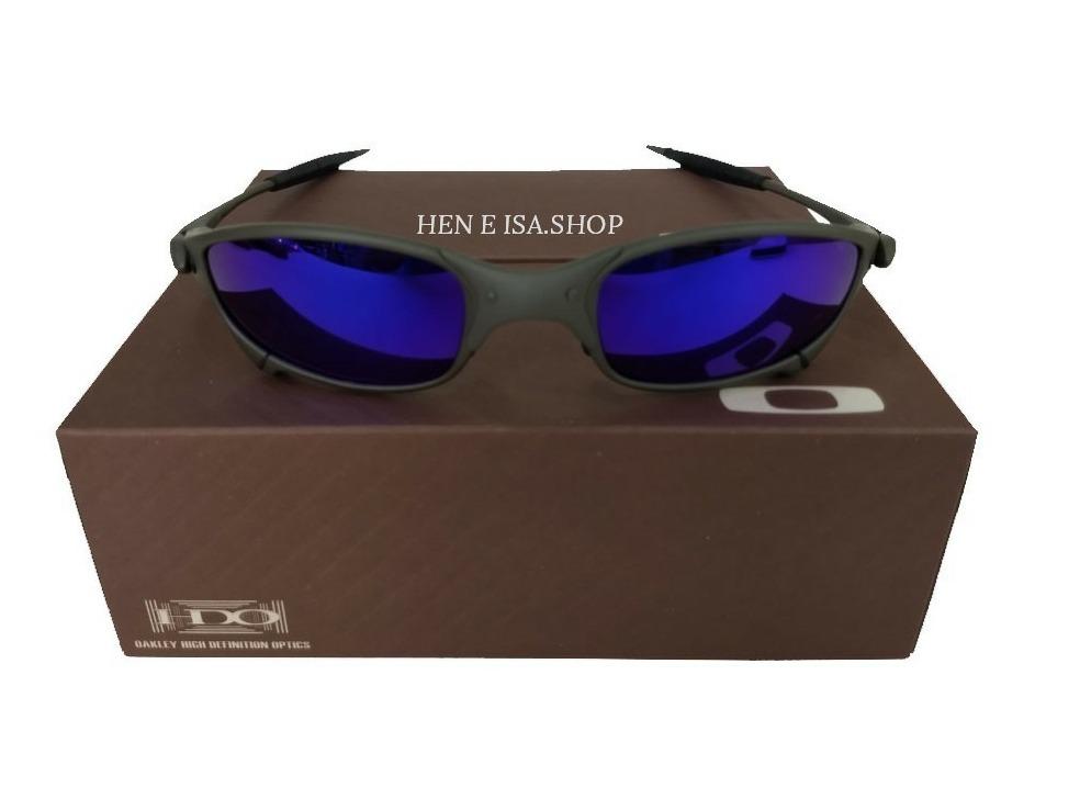 04f6fab636e25 oculos oakley juliet x-metal azul + caixa + saco micro fibra. Carregando  zoom.
