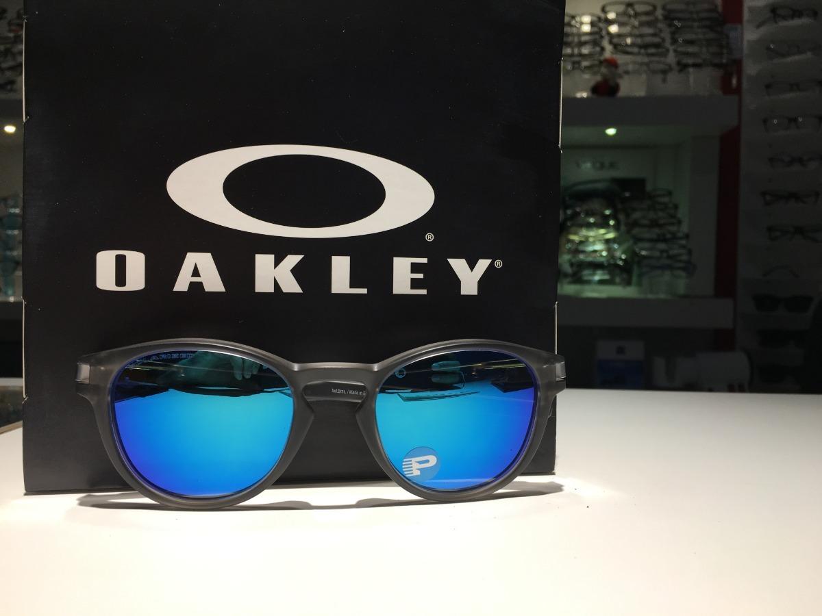 fe45971ed óculos oakley latch crystal grey lentes sapphire polarizada. Carregando  zoom.